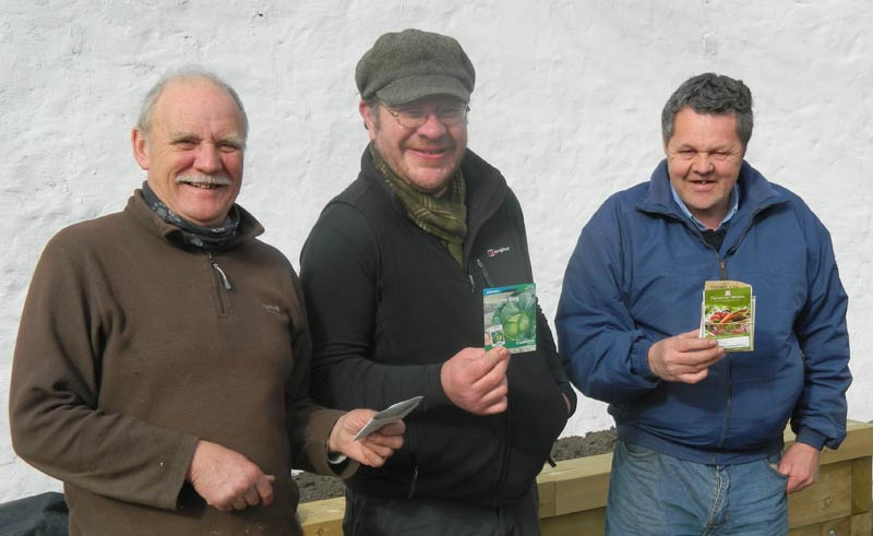 Jim, Simon Duffy from RBGE and Ward with trial seeds